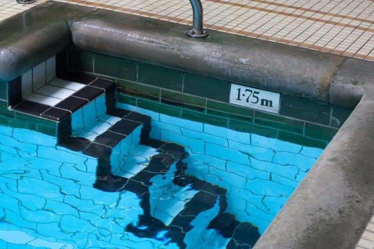 Steps out of the pool - image