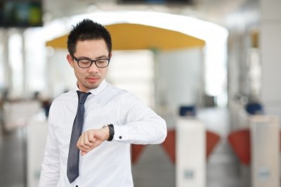 Man looks at watch