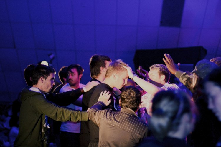 praying students group - image