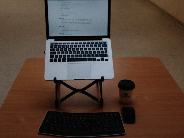 Roost laptop stand on desk with keyboard and mouse